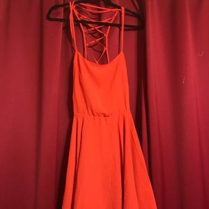 Orange dress with cut outs in back
